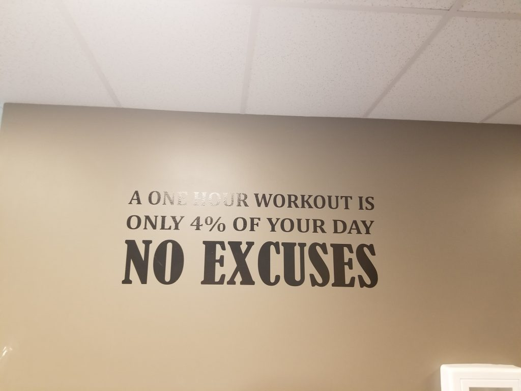 """photo of text on a wall that reads """"a one hour workout is only 4% of your day NO EXCUSES"""""""